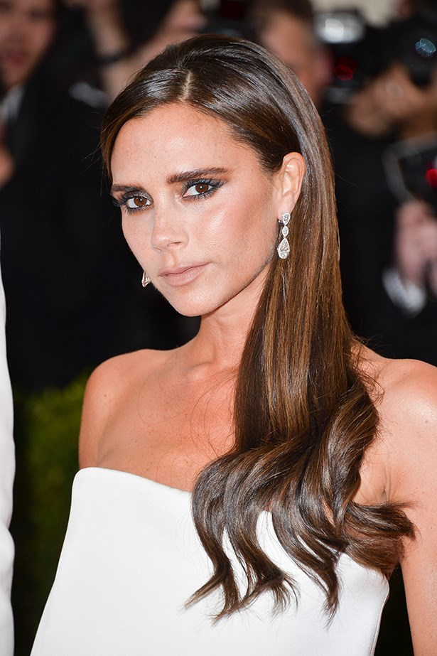 Victoria Beckham's glossy straight hair and subtle grey eye shadow were in keeping with her minimal dress.