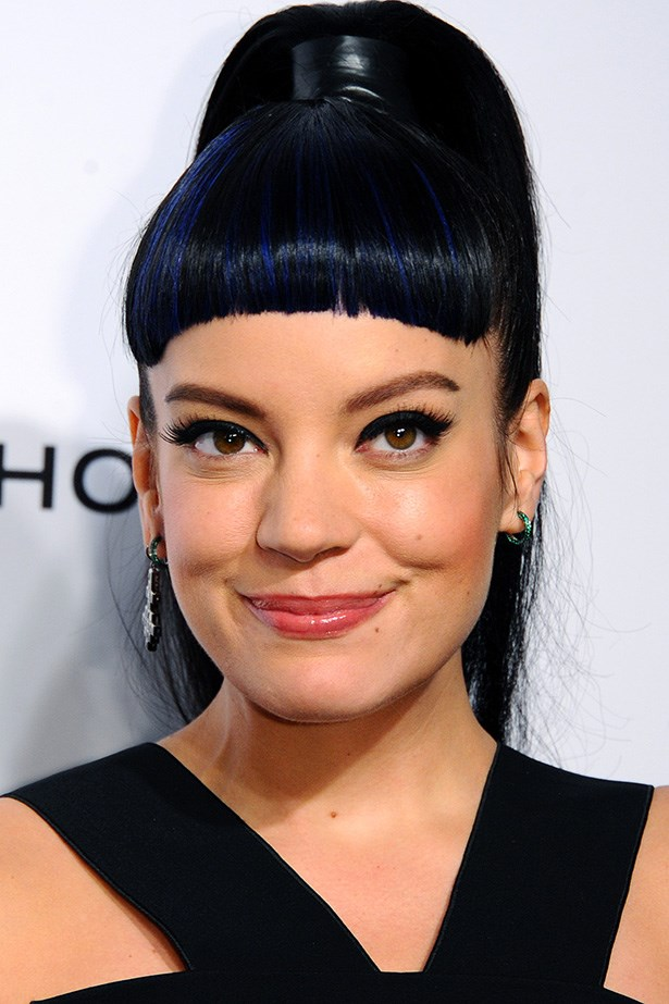 Later that month the singer swapped pink for midnight blue in a high slicked back pony tail and short fringe at the Elle Style Awards.