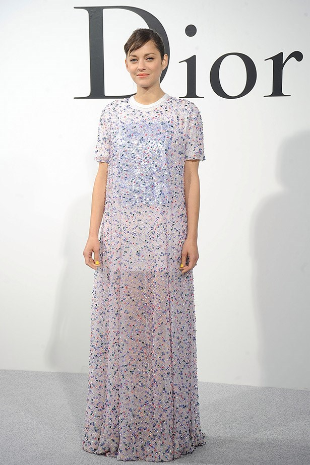 Marion Cotillard's layered Dior sheer silk evening dress and knitted t-shirt makes us want to try this trend.