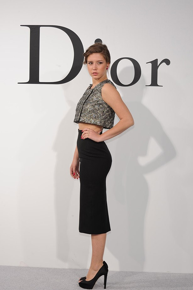 <em>Blue is the Warmest Colour</em> actress and face of Prada Adele Exarchopoulos, showed us how to freshen up a business-length skirt by pairing it with a cool metallic knitted crop, all Dior.