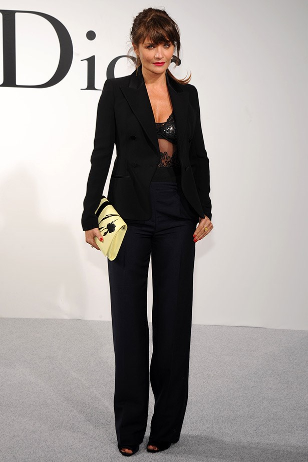 Model and photographer Helena Christensen's sexy suited look was another highlight. She paired a Dior black suit and sheer top with a cream Dior clutch.