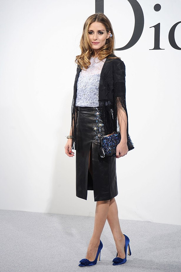 Front row favourite, Olivia Palermo doing what she does best: uptown girl cool. She wore a split leather skirt, lace top and blue velvet heels.