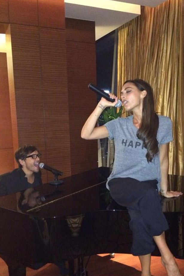Imagine walking into your hotel's piano bar to find Victoria Beckham belting out an impromptu performance of <em>Spice Up Your Life</em>? We're not sure what's going on here but we'd like to think its that.