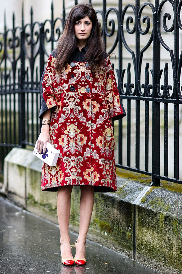 We love this voluminous, tapestry coat for a dark, rainy day.  Note how she's balanced it out with simple heels? A+