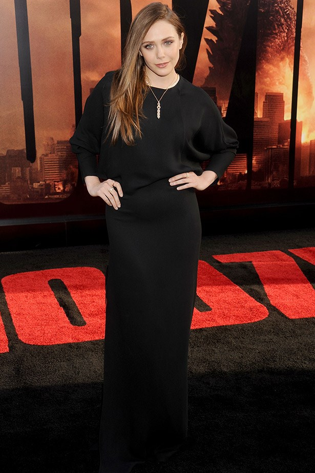 Elizabeth Olsen at the LA premiere of <em>Godzilla</em> wearing a beautiful long-sleeved Chloe gown.