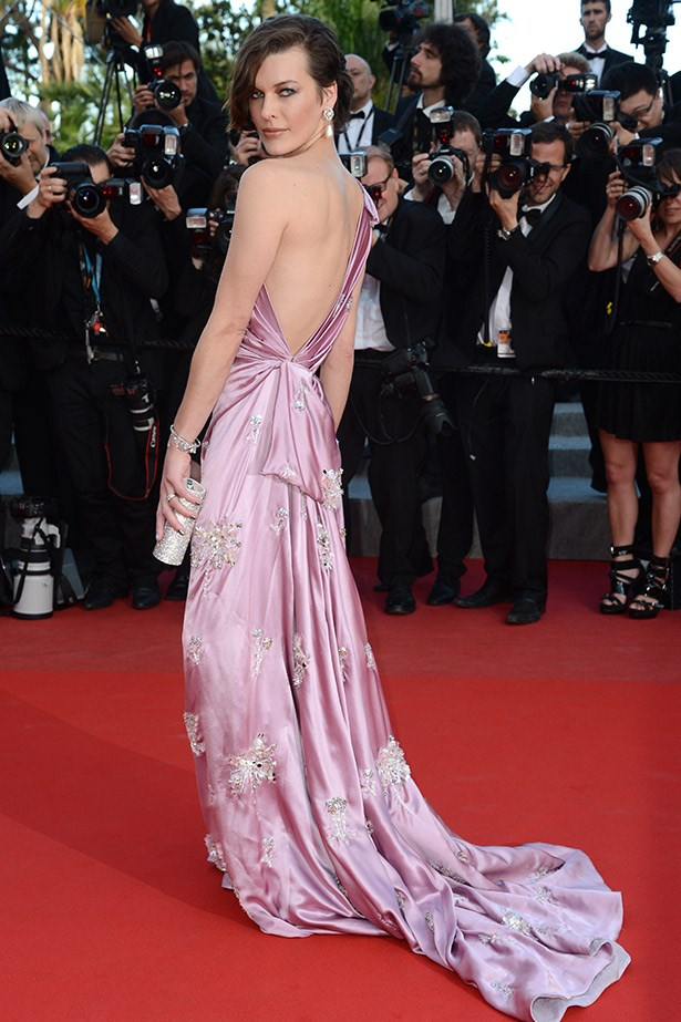 Milla Jovovich looks beautiful in this purple gown at Cannes in 2012