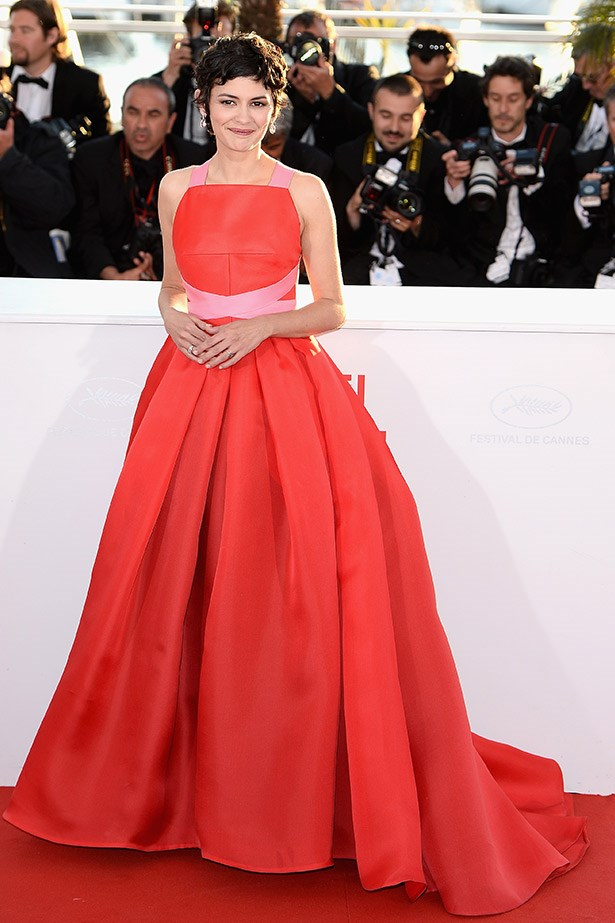 French actress Audrey Tatou wearing a red gown by Prada in 2013
