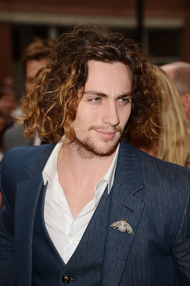A rugged Aaron Taylor-Johnson sports man-balayage at the 'Anna Karenina' premiere during the 2012 Toronto International Film Festival.