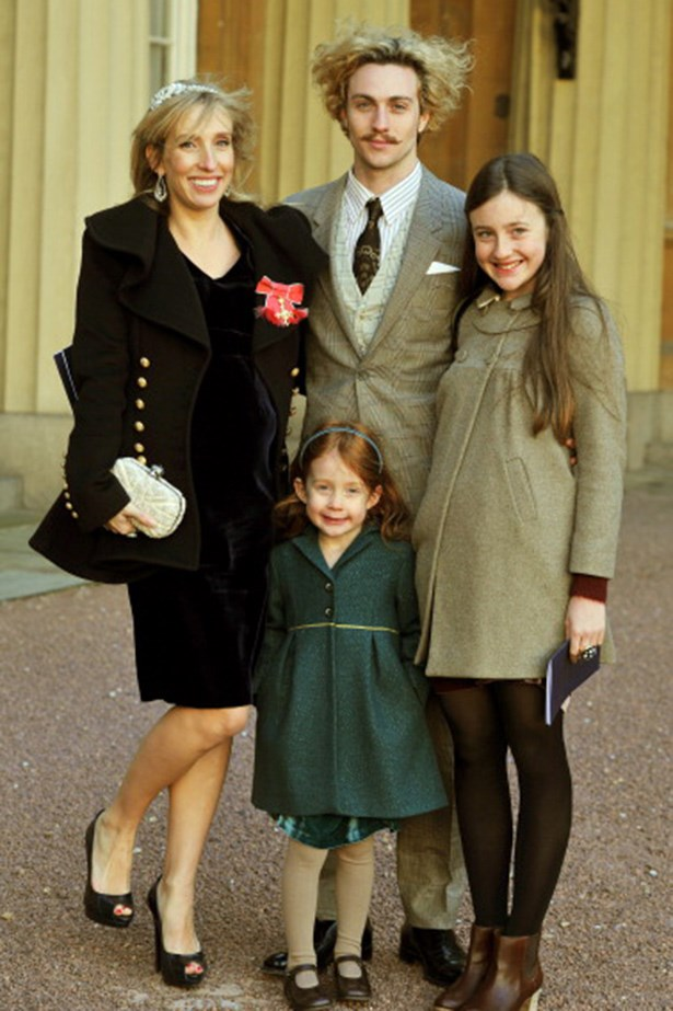 Aaron Taylor-Johnson doing his best mad-scientist impersonation with wife Sam and their daughters Angelica and Jessie during an official ceremony at Buckingham Palace in 2011.