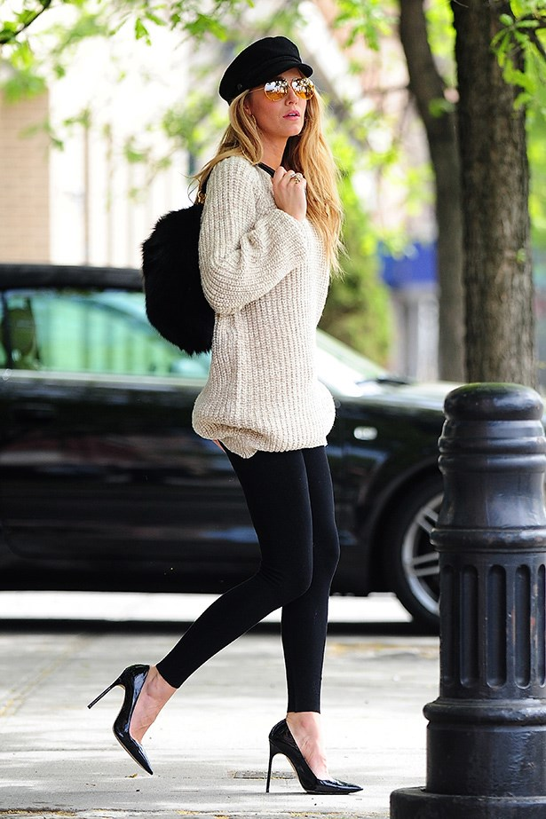 Blake Lively looks quintessentially Upper East Side in stilettos, skin-tight leggings and an oversized knit.