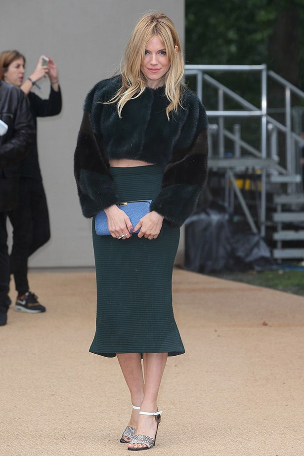If you're going to flaunt some skin, just remember to rug up the rest of you. Sienna Miller has the right idea in this furry emerald-green crop top.