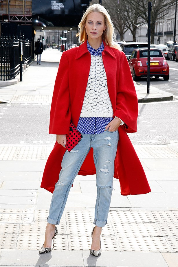 A cool breeze doesn't seem to faze Poppy Delevingne, as she layers a button-up shirt with a knitted jumper and statement coat.
