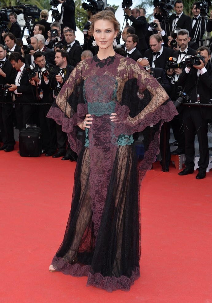 Karlie Kloss wearing a maroon lace gown by Valentino at the 67th Annual Cannes Film Festival.