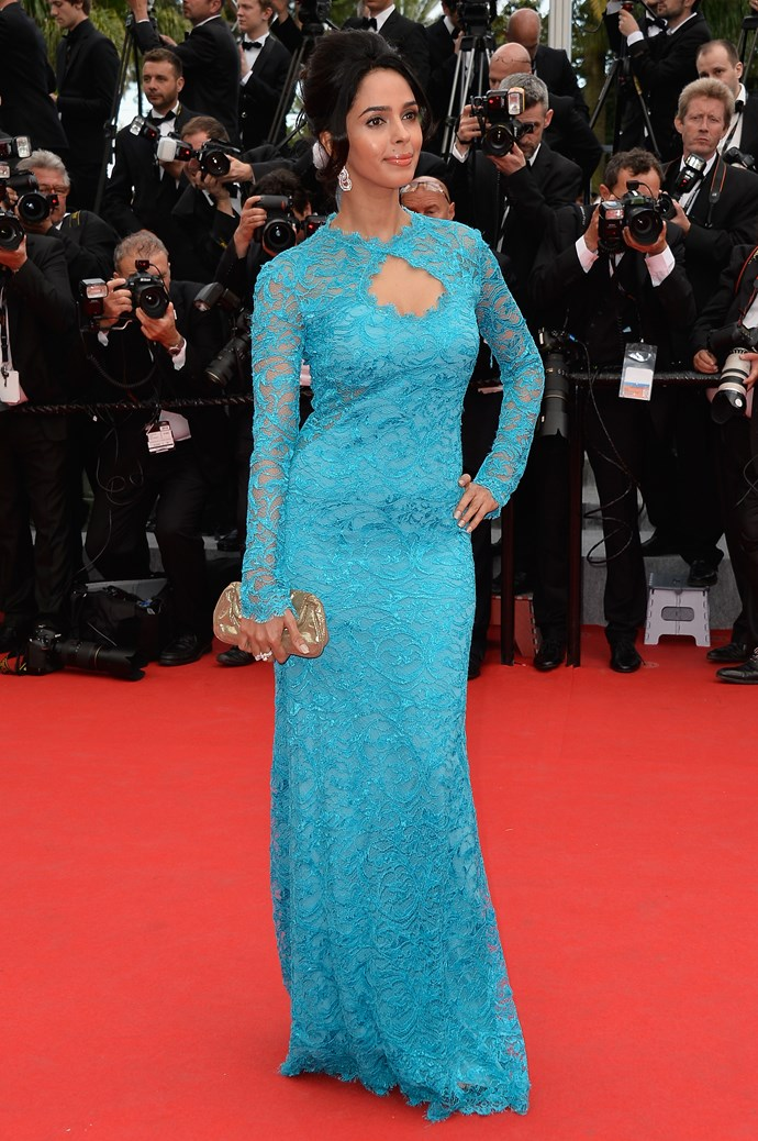 """Bollywood actress Mallika Sherawat wearing a blue lace dress at the 67th Annual Cannes Film Festival. <strong><br><br> <a href=""""http://www.elle.com.au/news/fashion-news/2014/5/cannes-40-of-the-best-dresses-of-all-time/"""">40 of our all time favourite looks from Cannes</a></strong>"""