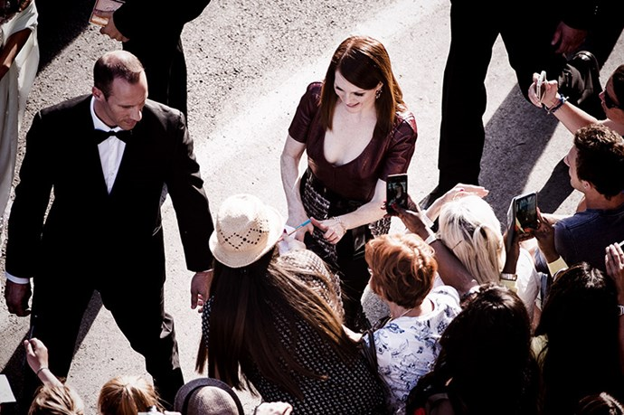 Julianne Moore signs some autographs for fans.