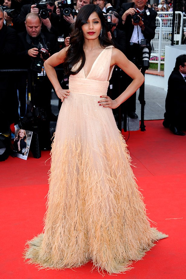 Attending the <em>Saint Laurent</em> premiere, Indian actress and model Freida Pinto looked incredible in this Michael Kors feathered gown.