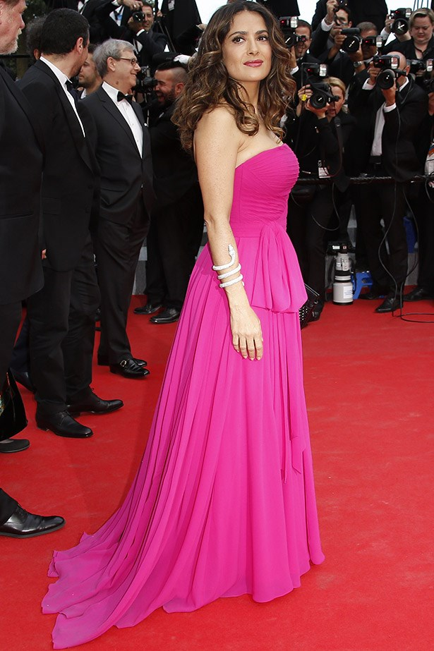 Looking radiant, Salma Hayek owns this a hot pink Saint Laurent gown to the premiere of <em>The Prophet</em>. Not an easy colour to pull off.
