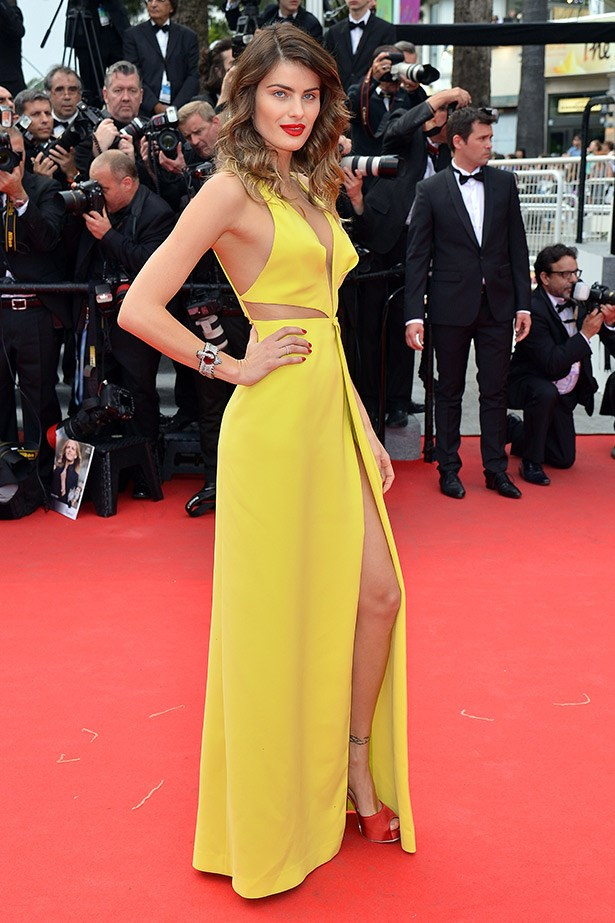 Brazilian supermodel Isabeli Fontana gives good leg in this yellow cut-out gown by Tufi Duek.