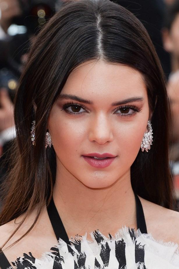 Kendall Jenner looks elegant and youthful at the <em>Grace of Monaco</em> premiere with luminous skin and lashings of mascara.