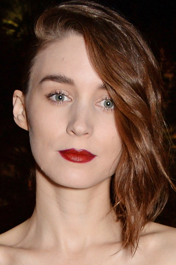 Rooney Mara stuns with a blood-red pout and trademark, sculpted brows at the Calvin Klein celebration of Women In Film.