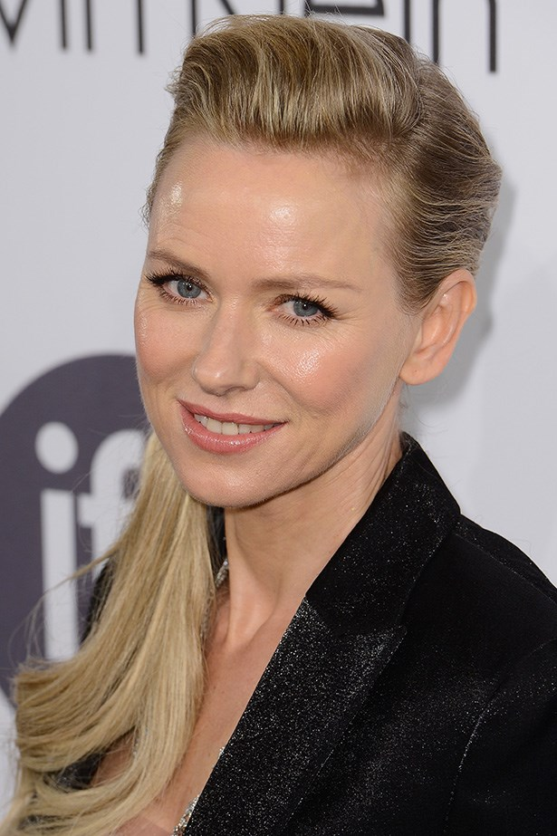 Bare-faced Naomi Watts attends the Calvin Klein Women In Film party with a lightly quiffed pony tail.