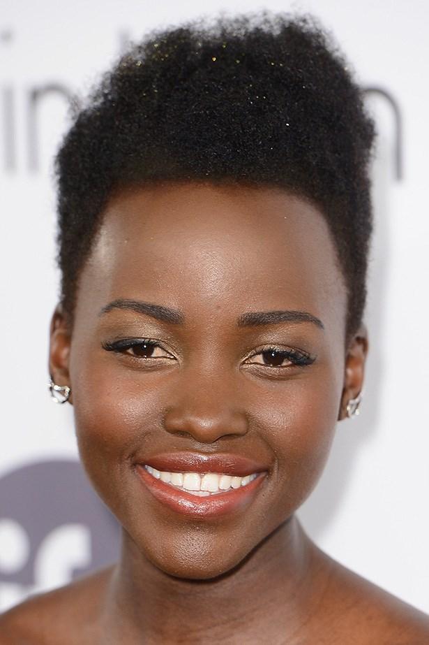 Oscar winner, Lupita Nyong'o glows with radiant cheeks and dash of silver shadow.
