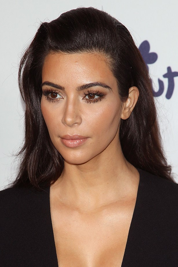 """<strong>Kim Kardashian's Radiance </strong><br><br> One of the many makeup artists Kim Kardashian uses, Troy Jensen, spilled his tips to <em>Allure</em> on how to get that Kardashian glow.  The trick, he says, is to apply highlighter before your foundation, dabbing some down the bridge of the nose, along the cheekbones, and even on the forehead. """"This mimics natural-looking skin."""""""