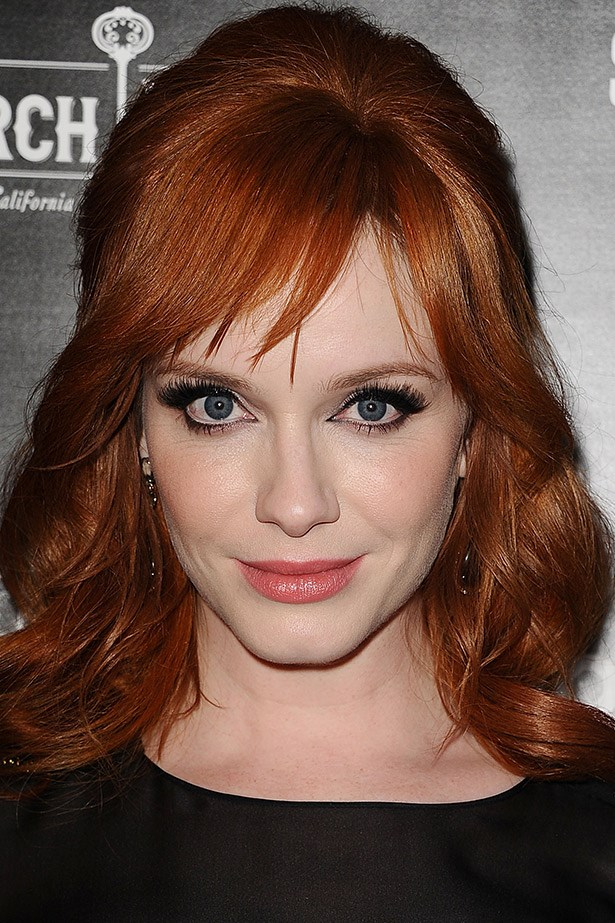 """<strong>Christina Hendricks' porcelain cool</strong><br><br As any peaches and cream redhead will know, it's often hard to get that balance of not-too-red, but not-too-sallow. To help balance this out, Hendricks' makeup artist, Vanessa Scali spoke to <em>Refinery29 </em> and suggested avoiding blush and lipstick with heavy blue undertones. """"Blue occurs naturally in any skin tone, particularly under the eyes, but it's especially prominent in redheads,"""" she says. However, she notes that blue eyeshadow or eyeliner will work really well on redheads: """"It just requires a very clean, precise application."""" She also says its ok to go for a pink tone, """"A simple pink lip can look really fresh and unexpected on a redhead."""""""