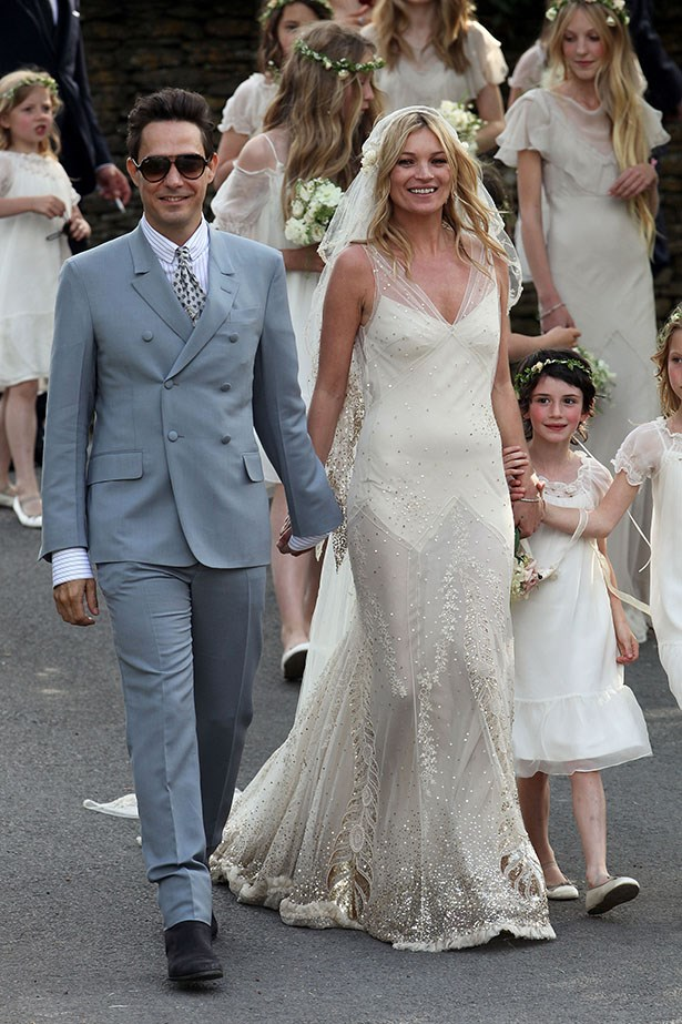 """Cloaked in 270,000 sequins, <a href=""""http://www.elle.com.au/news/celebrity-news/2014/5/kate-moss-career-advice-for-her-sister/"""">Kate Moss</a> was a bohemian dream for her nuptials to Jamie Hince in 2011. The supermodel turned to designer pal John Galliano for her dress, which is currently on display in the Victoria And Albert Museum in London."""