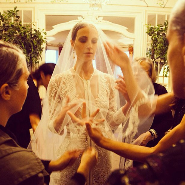 In head-to-toe Givenchy (we're talking veil, dress, rings and shoes...), stylist and consultant Vanessa Traina married photographer Maxwell Snow. The Riccardo Tisci design was based on one of the embroidered creations from his Fall 2010 collection. (Image via Samuel Lippke's Instagram: @samuellippke)