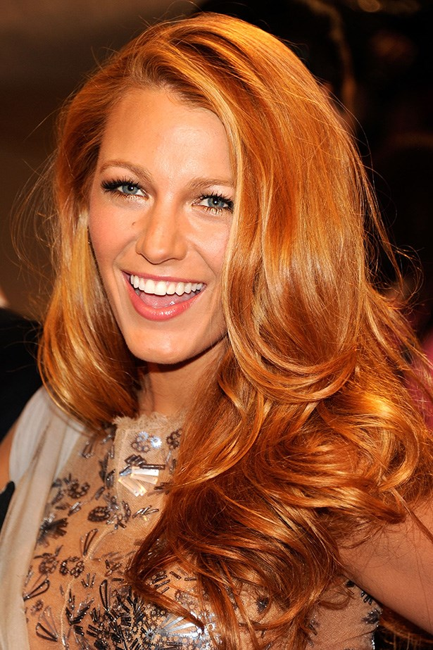 The actress attends the 2011 Met Gala on the arm of Karl Lagerfeld with bouncy copper-toned hair.