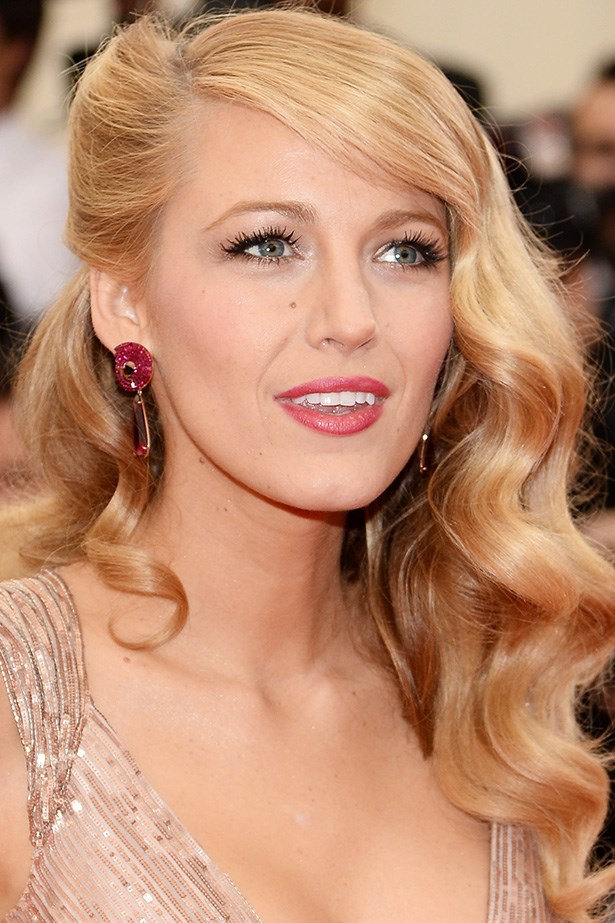 The beauty epitomises old Hollywood glamour at the 2014 Met Gala with side-swept finger waves and lashings of mascara.