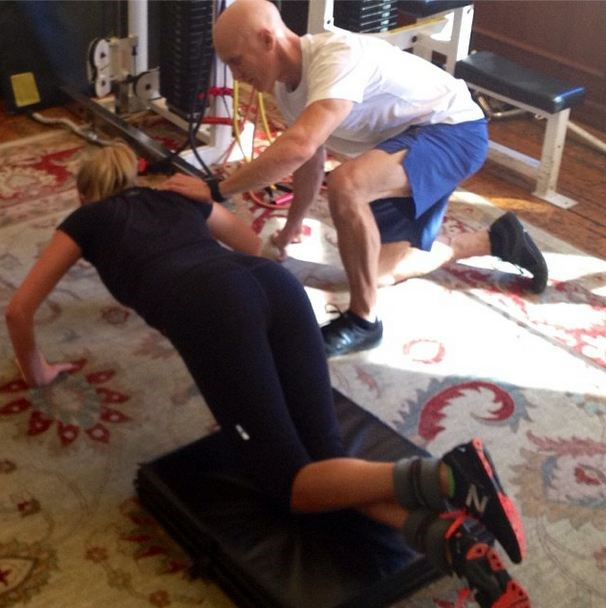 """<strong>On her workout for the film, <em>The Other Woman</em>:</strong> <br><Br> """"Depending on where they were shooting, we did five to seven days a week, usually pretty late at night for 60 to 90 minutes. I would have to get a babysitter to watch my girls and train her. It was very, very intense. It served two purposes: de-stressing and toning."""" Kate Upton and her trainer, David Kirsch working out together."""