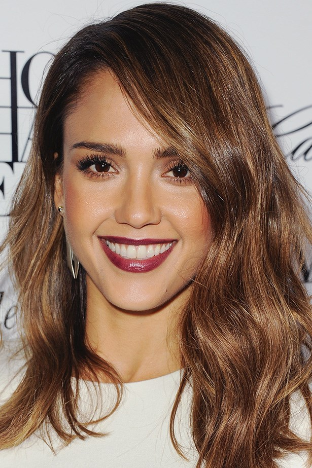 Jessica Alba pairs a berry lip and expertly-contoured cheekbones with soft waves at an event in Los Angeles.