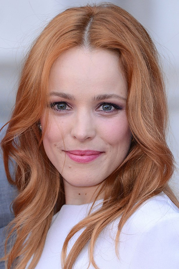 Rachel McAdams glows with rosy cheeks and copper-toned hair at the world premiere of <em>About Time</em>.