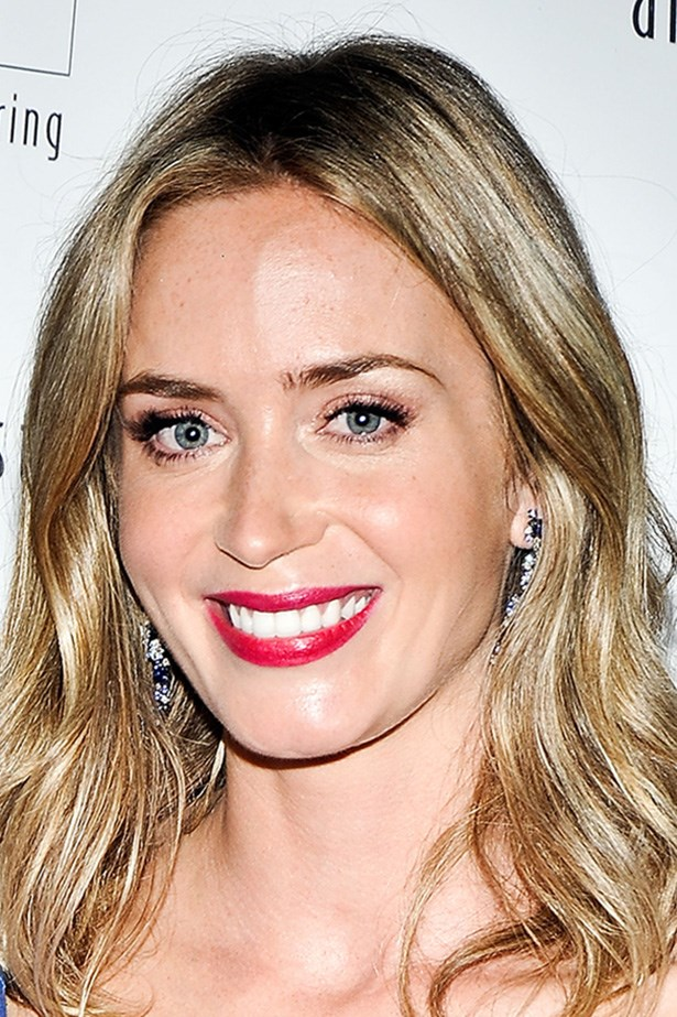 Emily Blunt trades in her brunette strands for honey- hued hair at an event in New York City.