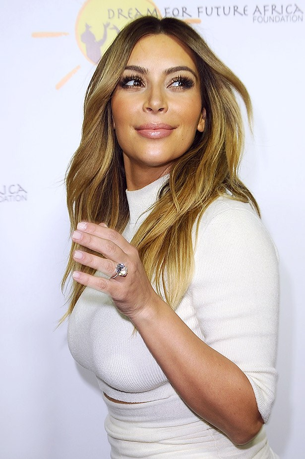 Kim Kardashian doing her best natural look, complete with peach blush,  brown eyeliner and a clear, fresh-looking lipgloss.