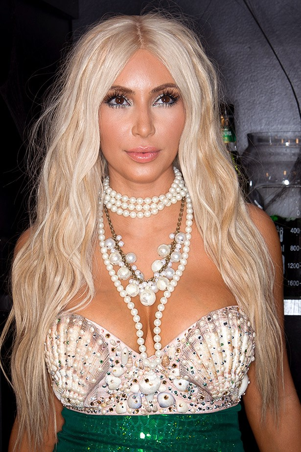 How do you feel about a blonde Kardashian? Kim looking hot as a mermaid at the Midori Halloween party in 2012.