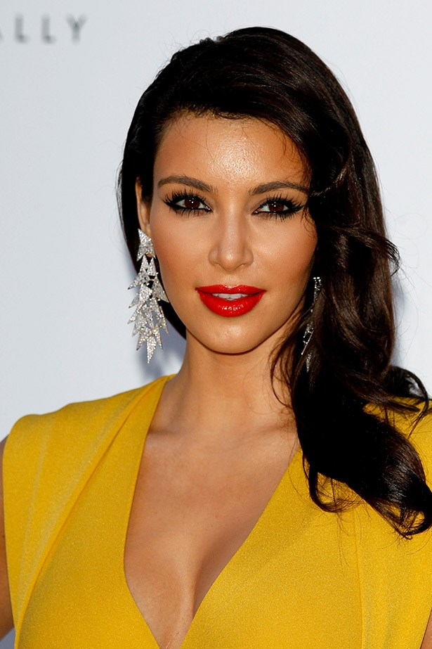 With a dark, khol-rimmed eye and a sexy, red lip, Kim Kardashian breaks all the rules of makeup balance, and pulls it off too.