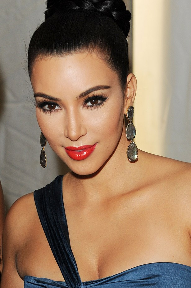 Front row at Vera Wang SS12 show, Kim K again goes for a glossy red and soft, smokey eye.
