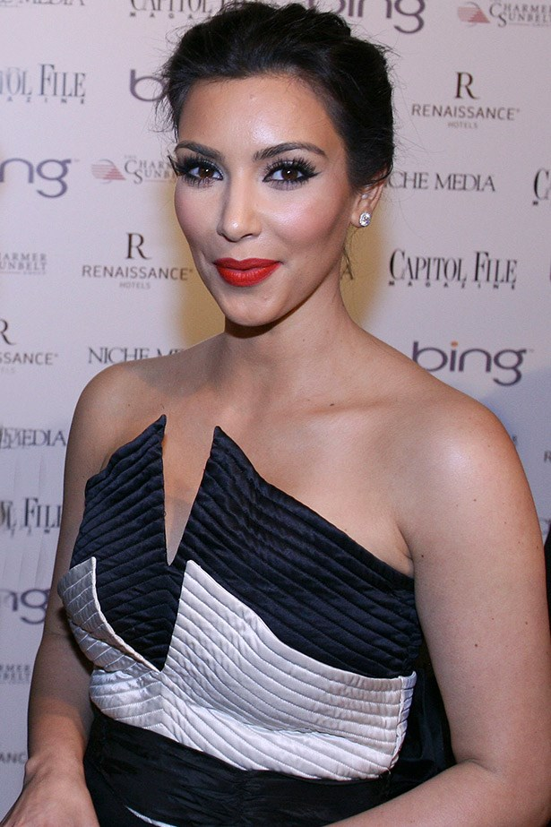 Departing from her usually tanned, matte skin in favour of a paler look,  Kim Kardashian glows at the White House Correspondents' Association dinner after party in 2010.