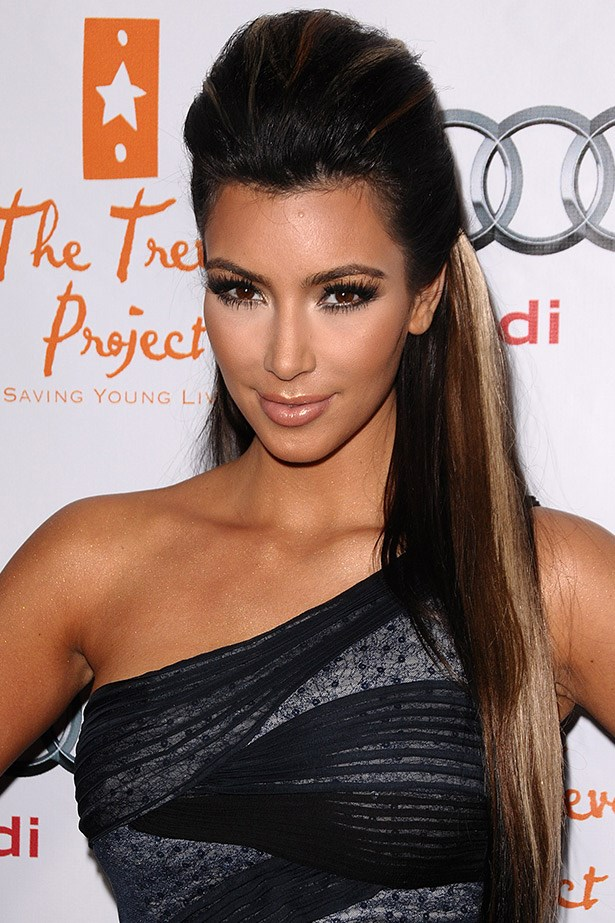 Snooki eat your heart out. Kim K gets bronzed & bouffant'd in 2009.