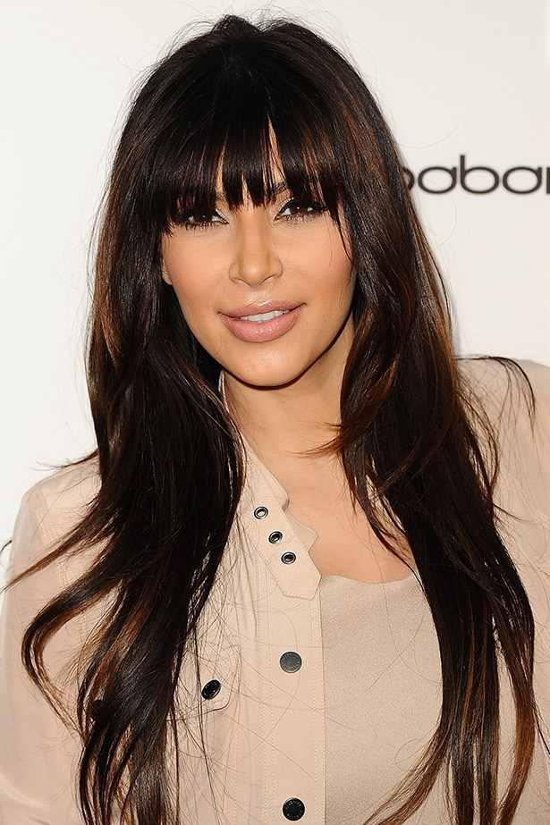 Experimenting with hairpieces 101: just have fun. Kim K wears a clip-in fringe to an event in LA last month.