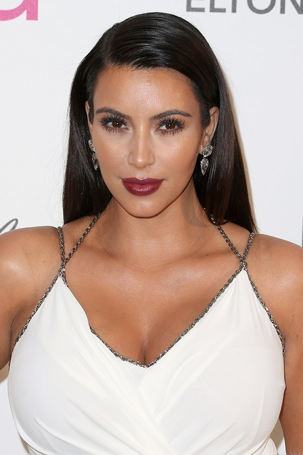 Kim K does illuminated goth chic. Very cool.
