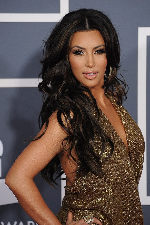 All that glitters: Kim K does illuminated goth chic. Very cool.: Kim channeling a a daytime soapie actress at the Grammy awards in 2011.