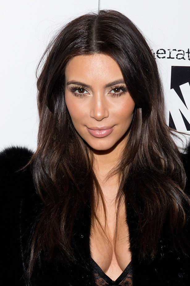 Kim's most natural look so far. Effortless waves, barely-there lips and peachy-tinted cheeks. Beautiful.