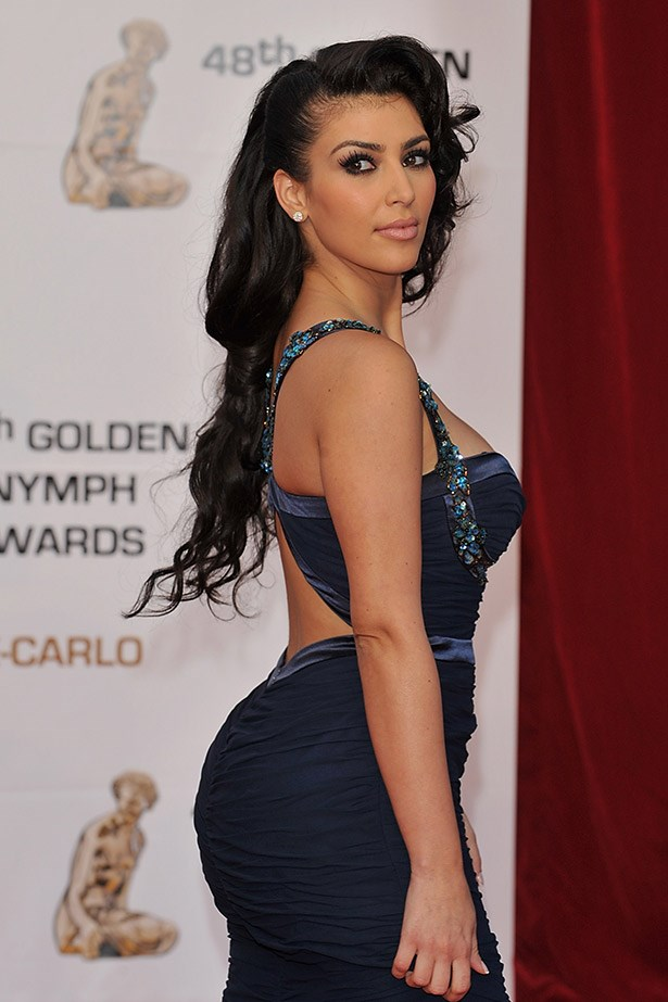 Cascading curls and khol-rimmed eyes: Kim Kardashian of 2008's most elegant red carpet look in Monte Carlo.