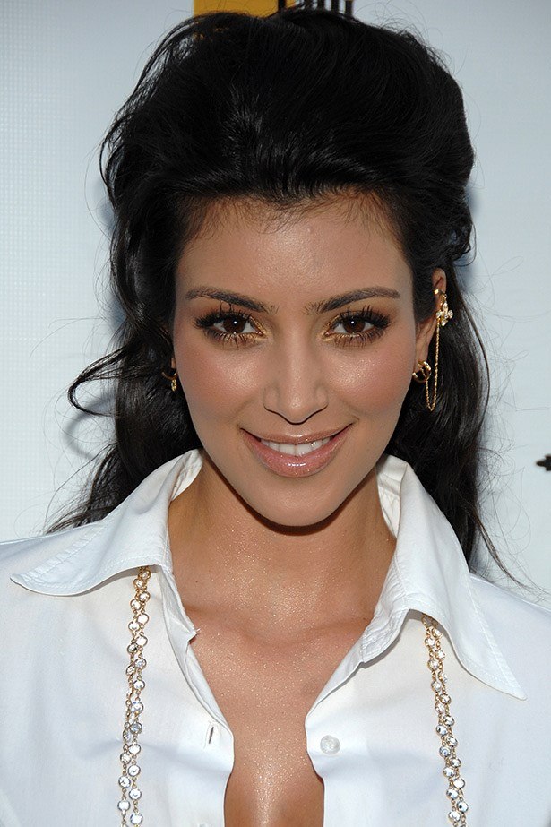 Kim Kardashian does gold-dusted eyes and a piled-high pony in 2008.