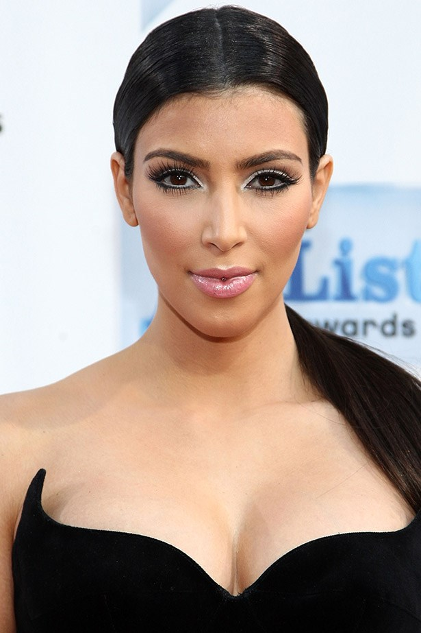 Kim Kardashian moves away from her round-brush blowrdries and into GHD territory with this poker-straight ponytail in 2009.