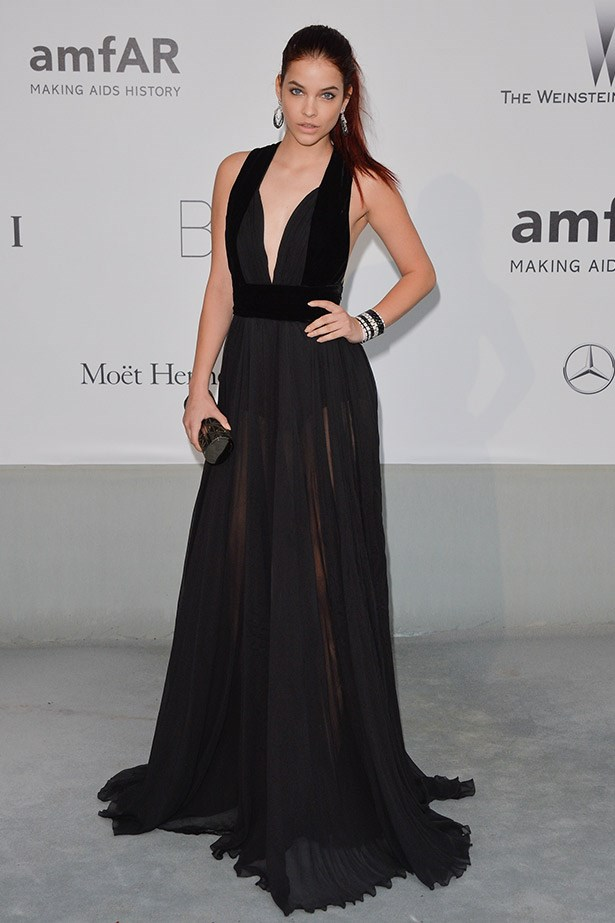 Newly redheaded model Barbara Palvin killing it in a sheer black plunge dress.
